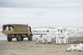 Rena oil spill - New Zealand Army personnel cleaning oil from Papamoa Beach on 11 October