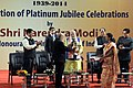Narendra Modi being presented a memento at the launch of the Platinum Jubliee Celebrations of Assam Tribune, in Guwahati. The Minister of State for Youth Affairs and Sports (Independent Charge), Shri Sarbananda Sonowal.jpg