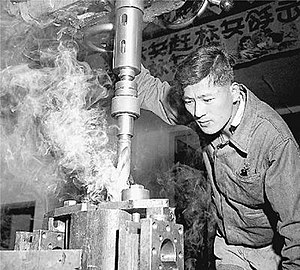 Ni Zhifu - Ni Zhifu operating the drill he invented (1959)
