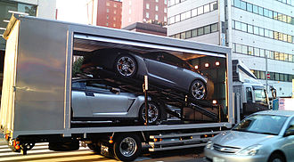 Development mule - Two blacked out Nissan GT-R test mules on a truck in Japan