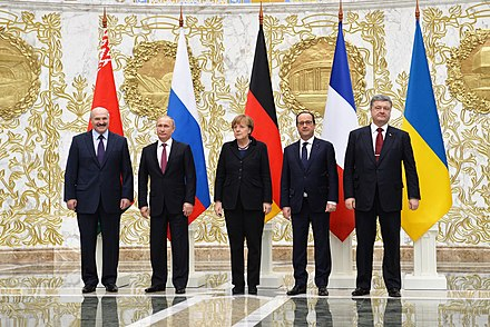 Leaders of Belarus, Russia, Germany, France, and Ukraine at the summit in Minsk, 11-12 February 2015 Normandy format talks in Minsk (February 2015) 03.jpeg