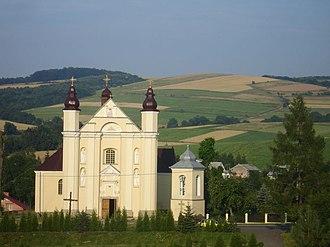 Nowotaniec - Main street in Nowotaniec, the centre of village. The latin church parish and Bukowica hill.