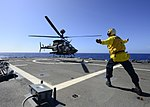 OH-58D of the 25th CAB landing on USS Lake Erie (CG-70) off Hawaii in 2013.JPG