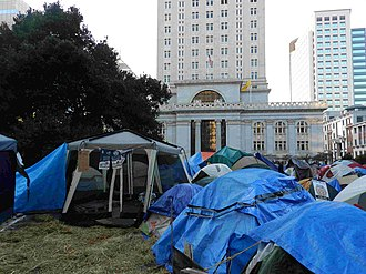 Occupy Oakland - Tents within the protest camp of Occupy Oakland at Frank H. Ogawa Plaza on November 12, 2011. Oakland City Hall stands in the background.