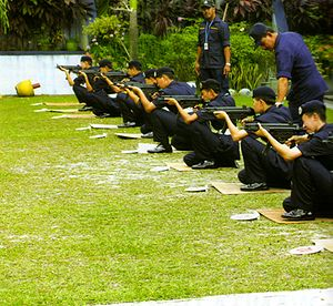 PULAPOL - Recruits of Royal Malaysian Police with senior police officers in a shooting course, armed with HK MP5 at PULAPOL Kuala Lumpur, Malaysia.