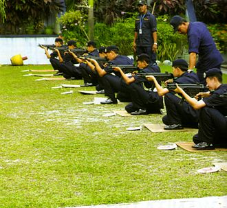 Royal Malaysia Police - Recruits of Royal Malaysia Police with senior police officers in a shooting course, armed with MP5 sub-machineguns at PULAPOL Kuala Lumpur, Malaysia.