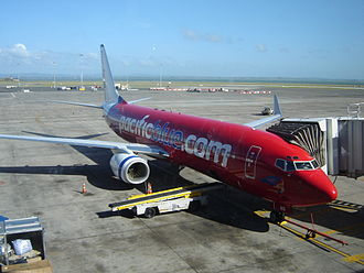 Virgin Australia Airlines (NZ) - The former livery of a Pacific Blue 737-800 at Auckland Airport in 2005