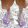Person wearing purple flip flops.jpg