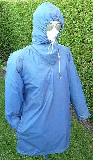 Cagoule - Vintage Peter Storm cagoule with zipped side-slit hand access to undergarments and extra-long sleeves with elasticated storm cuffs