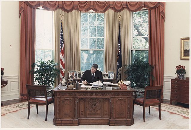 File Photograph Of President Reagan Working At His Desk In