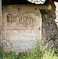 Pompei, regio I, insula 11, 10 orto, affresco con serpente.jpg