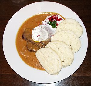 Czech cuisine - Svíčková na smetaně (Marinated sirloin), served here with dumplings and cream