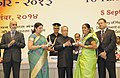 Pranab Mukherjee presenting the National Award for Teachers-2013 to to Smt. Tulsi Devi Tiwari, Chhattisgarh, on the occasion of the 'Teachers Day', in New Delhi. The Union Minister for Human Resource Development.jpg