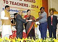 Pranab Mukherjee presenting the National Award for Teachers-2014 to Shri Vuppala Phaneendra Kumar, Andhra Pradesh, on the occasion of the 'Teachers Day', in New Delhi. The Union Minister for Human Resource Development.jpg