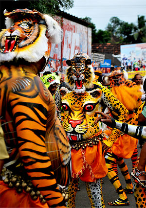 Visitor attractions in Thrissur - Puli Kali is the colourful folk art which can be viewed on the fourth day of Onam celebrations.