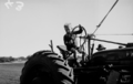 Queensland State Archives 1680 Child on tractor at demonstration of farm machinery 1944.png