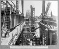 Queensland State Archives 3905 View of south anchor arm showing side girder of tower traveller and supply track along deck ready for stage Brisbane 13 December 1938.png