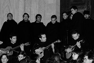 Fado - Coimbra students playing fado in a serenade at the frontdoor of Old Cathedral of Coimbra (Sé Velha)