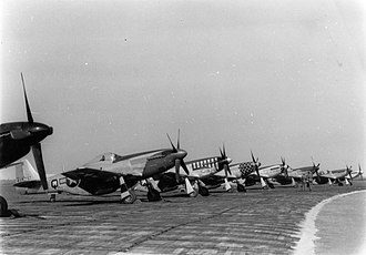 VIII Fighter Command - P-51D Mustangs (CV-Q) of the 359th Fighter Group, (LC-D) of the 20th Fighter Group, (LH-V) of the 353rd Fighter Group and (C5-Q) of the 357th Fighter Group, at RAF Debden, home of the 4th Fighter Group, 1945.