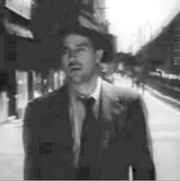 Ray Milland in The Lost Weekend with El in Background.jpg