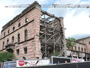 Mostar Round-Trip - Reconstruction of Tito's Palace in Mostar. The film depicts several buildings and structures that have been damaged during the Bosnian War, including Stari Most (the old bridge) which has been restored after being mostly destroyed during the war.