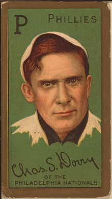 A baseball-card image of a red-haired man in a white old-style baseball jersey and cap