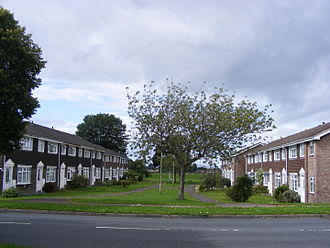 Radburn design housing - An example of Radburn design housing in Abbeydale, Gloucester, England with Redpoll Way (left) facing Redstart Way across a green space. Road access is to the rear of the houses.