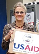 Robin Raphel delivering USAID.jpg
