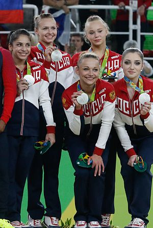 Angelina Melnikova - Melnikova (second from right) and the Russian team with their Olympic silver medals after the women's team final on 9 August 2016