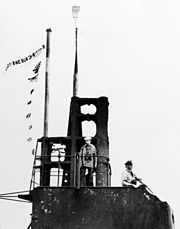 Sail of USS Wahoo (SS-238) at Pearl Harbor with broom, in February 1943