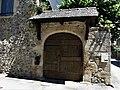 Sainte-Eulalie-d'Olt portail 1705.jpg