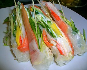 Fusion cuisine - Example of a fusion dish: combination of smoked salmon wrapped in rice paper, with avocado, cucumber and crab sticks
