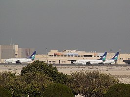 Saudi Aramco airplanes parked in the general aviation terminal, King Fahd International Airport.JPG