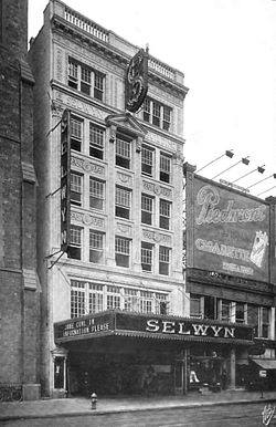 "Facade of six-story office building, with theater marquee on street floor, reading ""Selwyn Theatre"" and ""Jane Cowl in Information Please"""