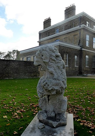 Sheerness Dockyard - A stone lion from the demolished 17th-century garrison gatehouse sits in front of Dockyard House.