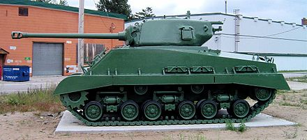 M4A2(76) HVSS with T23 turret and later 76 mm gun's muzzle brake; it also sports fenders, usually omitted on U.S. vehicles to ease maintenance Sherman m4a2e8 cfb borden 3.JPG
