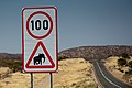 Signpost on the road to Etosha in Namibia -16July2009.jpg