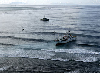 Pacific-class patrol boat - The Solomon Islands patrol boat Lata assisting a stranded fishing vessel (foreground)
