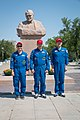 Soyuz MS-05 backup crew in front of the statue of Sergey Korolev.jpg