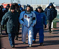 Soyuz TMA-07M crew member Chris Hadfield is escorted to the rocket.jpg