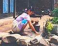 Squat woman at the dishwashing in Nepal.jpg