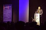 Stadtkulturpreis Hannover 2013 (111) Roger Cericius, Erster Vorsitzender vom Freundeskreis Hannover, begrüßt die rund 450 erschienenen Gäste neben einer Stellwand.jpg