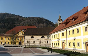 Ruard Manor - Stara Sava, the central square. From the left to the right: Ruard Manor, Church of the Assumption of Mary, Worker's Barracks