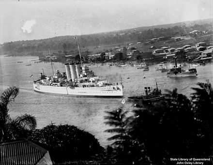 Canberra being towed along the Brisbane River[clarification needed] - HMAS Canberra (D33)