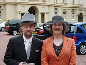 Christine Burns - Stephen Whittle (OBE) and Christine Burns (MBE) at Buckingham Palace