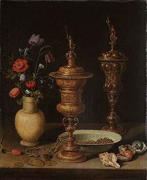 Clara Peeters - Still Life with Flowers and Gold Cups of Honor, 1612, with reflections of the artist on the bosses of the cup at right