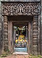 Stone gate with columns and Buddhist reliefs leading to a clothed statue of the Buddha seated, Wat Phou temple, Champasak, Laos.jpg