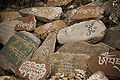 Stone tablets with prayers in Tibetan language at a Temple in McLeod Ganj.jpg
