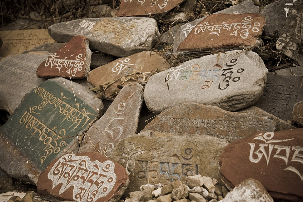 Stone tablets with prayers in Tibetan language at a Temple in McLeod Ganj