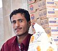 Storeman, Al Mahweet, Yemen (16344885905).jpg